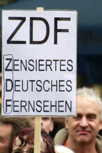 "The sign reads, ""ZDF – Censored German TV"" — munichFOTO"