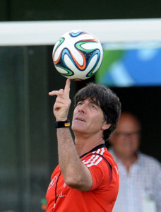 Head coach Joachim Löw balances the official match ball during a training session of the German national soccer team at the training center in Santo Andre, Brazil, 10 June 2014. The FIFA World Cup 2014 will take place in Brazil from 12 June to 13 July 2014. Photo: Andreas Gebert/dpa