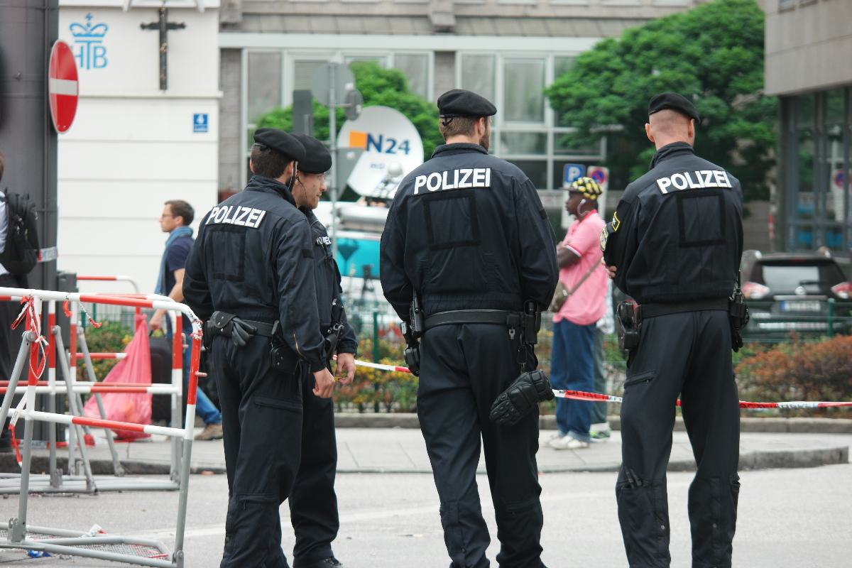 Police watch over the arriving immigrants at the Munich train station -- munichFOTO