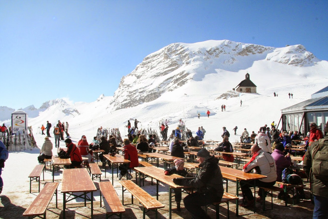 Skiers and hikers enjoy lunch and some sun on the alpine terrace -- munichFOTO