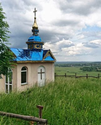 A small chapel stands as a lone sentinel watching over the fields in a valley near Chekova, in the Ivano-Frankivs'k Oblast. Photo; Michael V. Owens