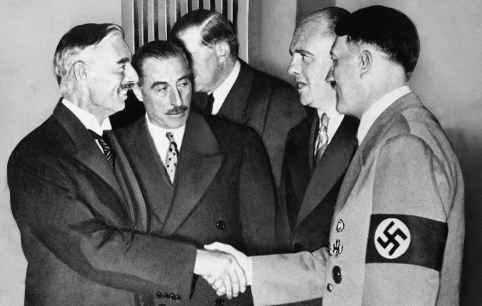 Chamberlain and Hitler shake hands following the signing of the document -- photo: public domain