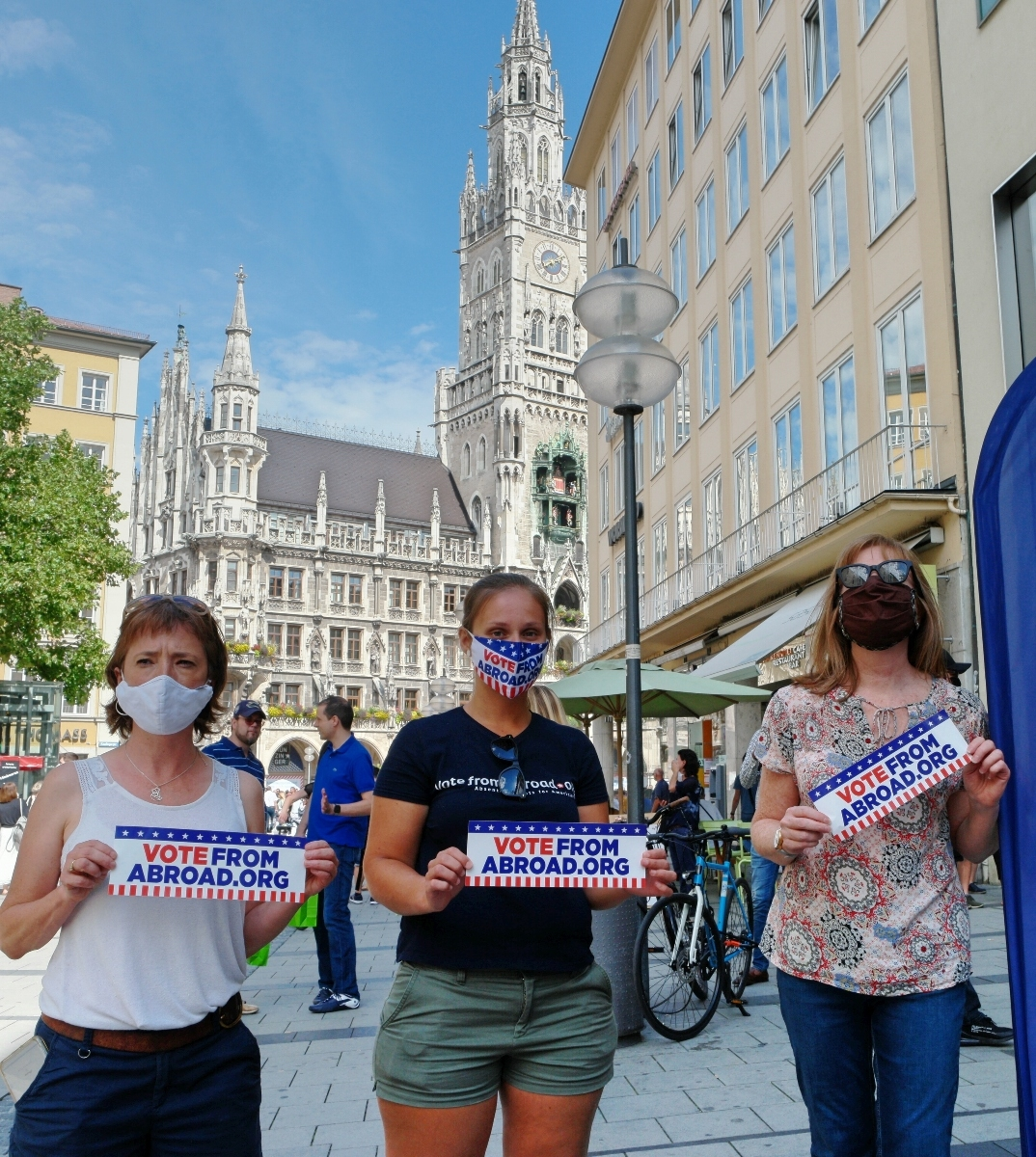 Sarah Carr, Candice Kerestan, and Heather Storm in Munich's Marienplatz as part of VoteFromAbroad.com's voter registration drive -- munichFOTO